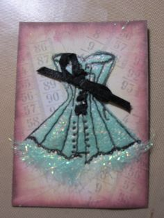 ATC with Clarity stamps & fusible fibers. We use Dicrofibers.