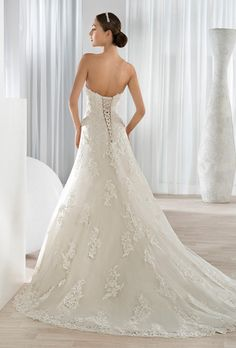 Brides: Demetrios. Romantic beaded lace modified A-line gown features a plunging sweetheart neckline with a lace-up back and chapel length train.