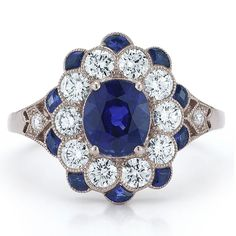 Brides.com: Unique Engagement Ring Settings. Style 28057S, Vintage Collection ring with 2.62 carats of blue sapphires and diamonds set in 18kt white gold, $10,700, Kwiat  See more Kwiat engagement rings.