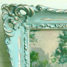 She spraypainted it gold, painted in blops of Provence, Antibes Green, and wet the thing and washed it with Old White.  After it was all to her liking she rubbed on a copper glaze.