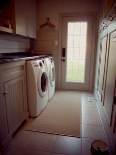 A small backdoor entrance way can be the perfect spot for laundry room. #chriskauffman #laundryroom #mudroom