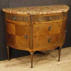 3200€ French demi lune dresser in Louis XVI style of the 19th century. Visit our website www.parino.it #antiques #antiquariato #furniture #inlay #antiquities #antiquario #comò #commode #dresser #chest #drawer #golden #gold #decorative #interiordesign #homedecoration #antiqueshop #antiquestore #inlaid #inlay