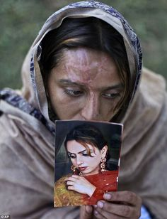 Survivor: Acid attack survivor, Shamma Maqsood, 24, holds a picture of herself before the vicious assault. Shamma was attacked by her husband on March 20, 2012, following an argument about him being jobless