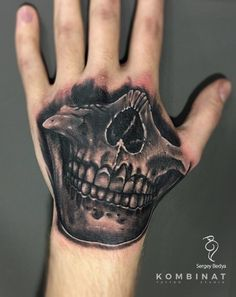 Skull tattoo on hand (palm) black and grey by Sergey Bedya Joker Smile Hand Tattoo, Left Hand Tattoo, Skeleton Hand Tattoo, Hand Tattoos For Guys, Bull Skull Tattoos, Evil Skull Tattoo, Skull Sleeve Tattoos, Dope Tattoos, Badass Tattoos
