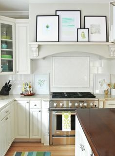 :: Havens South Designs :: loves art in the kitchen. Use corbels as mantel shelf over sink for art and glasses