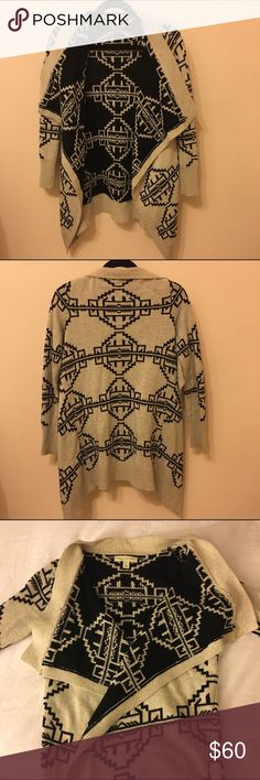 Urban Outfitters Tribal Sweater Tribal pattern sweater from Urban Outfitters. Tan outside/black inside. Can be worn inside out. Urban Outfitters Sweaters Cardigans