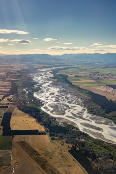 The Waimakariri River Canterbury New Zealand braiding its way to the Pacific Ocean from the mountains [OC] [1733x2600]