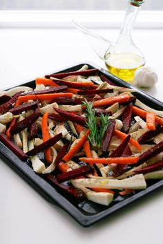 A classic root vegetable recipe: Roasted Parsnips, Carrots and Beetroot. Hearty and warming. Soft on the inside and crispy on the outside. This is an easy perfect roasted veg dish!