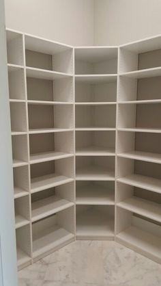 Custom pantry shelving with corner shelves. All adjustable shelves.