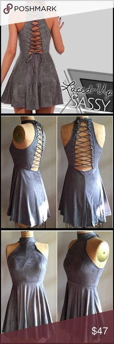 Lace-up Mini Dress Lace-up Mini Dress; high neckline; soft sueded fabric; lace up back; A-Line silhouette; mini dress length; poly/spandex blend; runs VERY small. Boutique Dresses