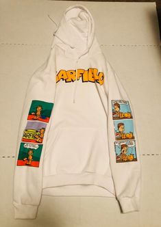 Garfield Comic Hoodie , NWT Size Small on Mercari Garfield Cartoon, Garfield Comics, Painted Clothes, Mens Fashion, Fashion Edgy, Diy Clothes, Memes, Comfy, Unisex