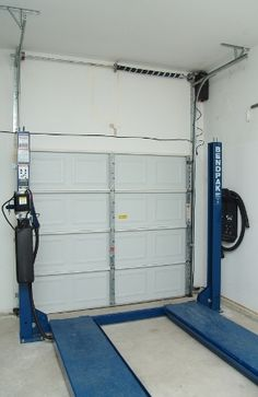 Garage door high lift conversion to fit a inside car lift for the garage.  Anything is possible!!!