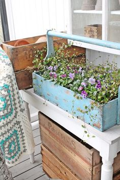 Something about an old tool caddy filled with flowers.....always so charming!