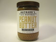 Packaging design for a fictional peanut butter company. Maynard's strives for the highest quality product and this is reflected in the package. The container is a glass jar with a heavy paper label, which has a subtle tactile texture. A simple color palet…
