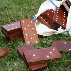 DIY Outdoor Dominoes -- These over sized dominoes will keep family members of all ages entertained in the back yard.