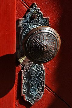 red door ~ beautiful detail on antique door knob