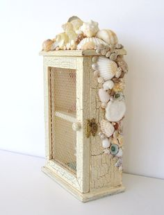 cute cabinet for a beach inspired bathroom