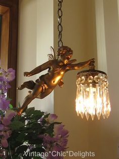 French antique bronze crystal cherub chandelier.