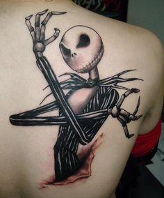 Cartoon character tattoo on back