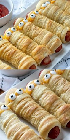 These super fun Halloween favorite Mummy Dogs are hot dogs wrapped with crescent rolls. Not only are they fun to eat, they are super yummy to eat before going out trick or treating. Perfect for parties, family meals, or just because you want to surprise the kids. Halloween Desserts, Plat Halloween, Comida De Halloween Ideas, Hallowen Food, Halloween Dinner, Halloween Food For Party, Party Desserts, Halloween Finger Foods, Halloween 2020