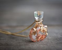 Hey, I found this really awesome Etsy listing at http://www.etsy.com/listing/167994400/resin-pendant-perfume-bottle-gold-flakes