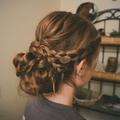 Prom hair updo. //Separate hair from below the ear to the other ear and make a low bun. Curl the top pieces above and part hair from back of ear to the corner of forhead on both sides of head. Make a french braide on both sides with the small sections. Next, take the curled pieces in the last big section and gently roll them into loops and layer above the bun, pinning them down securely. Fit the braids over the crease of the bun, wrap them around, pin, and you're done! //