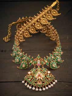 Antique Manga Malai in emerald with ruby and diamond details, 22k.