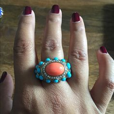 Kenneth Jay Lane Coral Turquoise Swarovski Ring In good used condition. All stones in tact. Some scratches on underside and side of band but not visible during wear. Coral center stone with turquoise and Swarovski Crystal accents. 22kt gold plated. One size - inner adjustable sizing band. KJL stamped. Kenneth Jay Lane Jewelry Rings