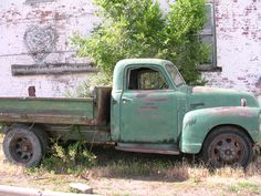 Old truck in front of the Feed & Grain in Loveland, CO