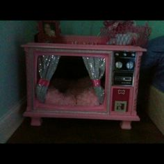 Made my parents console tv into my dogs bling bed! She loves it!!!
