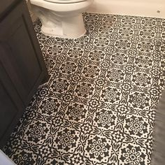 A black and white bathroom stenciled floor over an old vinyl tile floor. Stencil is the Amalfi Tile Stencil from Cutting Edge Stencils DIY project by @_fauxfarmhouse_builder  http://www.cuttingedgestencils.com/amalfi-tile-stencil-Cement-tiles-stenciled-floor-backsplash.html
