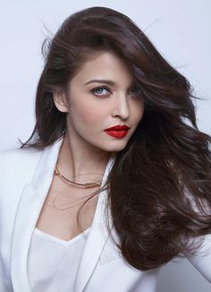 Aishwarya Rai Bachchan nailed it in all white formal attire with her Cannes 2014 trademark red lips in a photoshoot for L'Oreal. #Style #Bollywood #Fashion #Beauty #Cannes2014