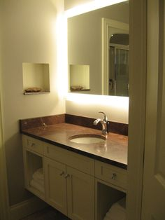 Cape Breton marble counter with Onyx floor and custom lighting.