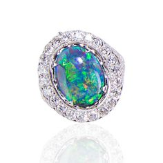 Black opal ring with a diamond Day Night setting