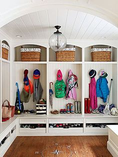 MUST HAVE in my next home. Shoe drawers & cubbies with hooks for each person!