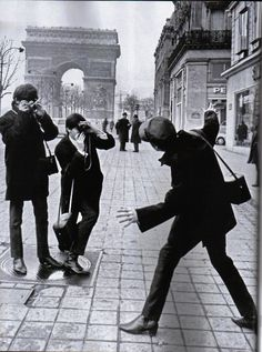 The Beatles clowning around in Paris