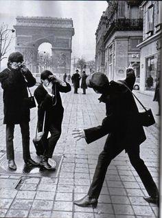 The Beatles clowning around in Paris