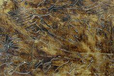 particolare pannello inciso finitura bronzo antico