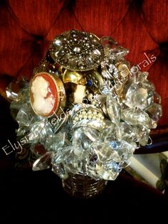 vintage brooches & antique glass crystals from a chandelier ~
