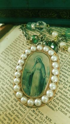 Check out this item in my Etsy shop https://www.etsy.com/listing/483719849/ooak-religious-assemblage-virgin-mary
