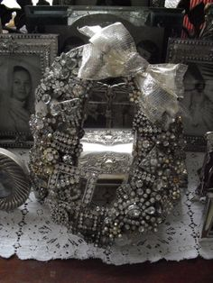 i made this tiny wreath using vintage rhinestone jewelry, buttons, buckles, tinsel ribbon ~mbr~