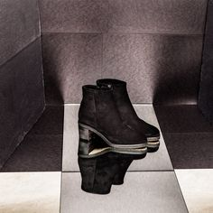 BLACK TRIUMPH  Only one color: #Black. During the eighties the black has been turned into a declaration of intellectual style, becoming synonym of elegance. Ankle #Boots with zip and rubber sole, in a soft black #suede: the right color for any time.