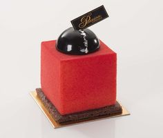 Le Cube - chocolate mousse with raspberry, lemon, and pistachio. French pastry by Gerard Dubois.
