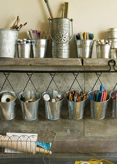 jmu'This arts storage setup was styled for a magazine, but there's no reason you couldn't pull it off in your home. Ikea's kitchen storage accessories and other galvanized tins are attractive, functional and flexible.