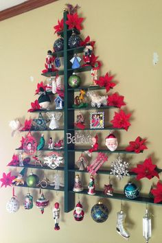 Wall christmas tree too cute! There are hooks to hang ornaments on the underside of the shelves and room underneath to place presents!