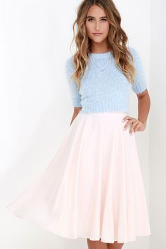 No need for adjustments, the Fine Swoon Pale Blush Midi Skirt is absolutely perfect the way it is! Woven poly in a lovely shade of pale blush shapes this chic midi skirt with a fitted high waistband. Skirt flows to a full and figure-flattering silhouette that is perfect for twirling! Hidden zipper/hook clasp at back.
