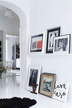 pictures on a ledge and on the floor #home #deco