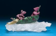 <i></i><i>Designed by Luis Alberto Quispe</i><br />An imaginative carving depicting two carved ruby mice in a bowl of bright green zoisite from Tanzania. They paddle their leaf-shaped boat across rough seas suggested by the removable frosted rock crystal quartz base, <i>measures 9 x 5 ½ x 5in.</i><br /><i></i>