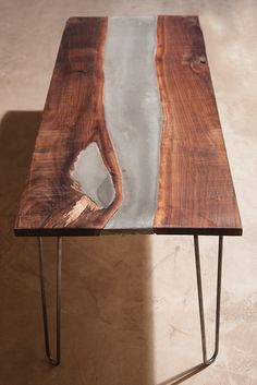 "This is a Coffee table I designed and built. I utilized a live edge walnut slab and countertop quality concrete. The legs are custom fabricated hairpin legs, made with .5"" steel rods."