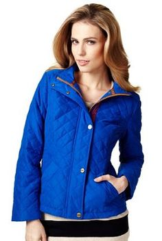 This blue Per Una funnel neck quilted jacket with is built in with Stormwear™ technology.
